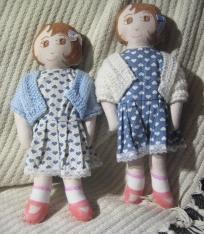 Pair of blue dressed dolls